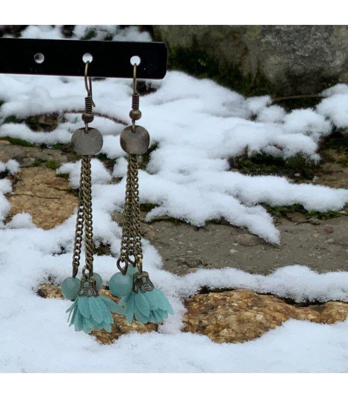 Boucles d'oreilles en acier bronze pompon bleu ciel